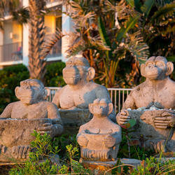 four monkey statues by costa d'este