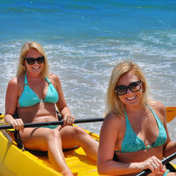 two women kayaking in the ocean on vero beach