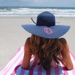 woman tanning on vero beach with big hat