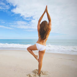 woman doing yoga on vero beach