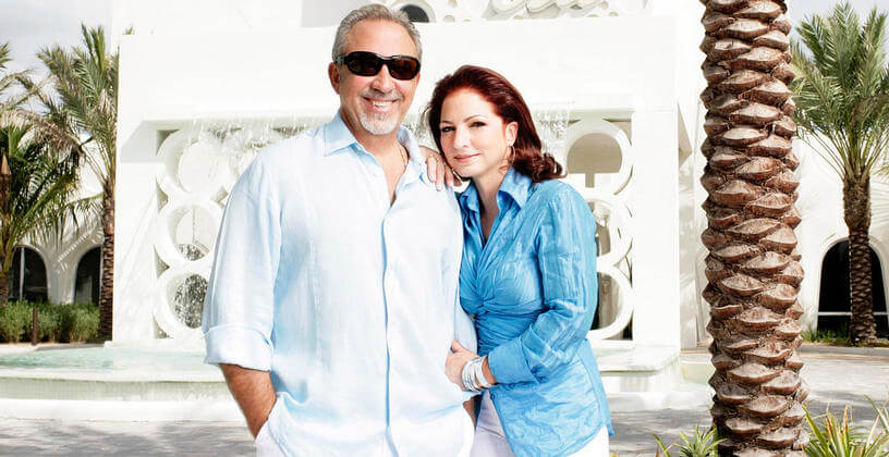 gloria estefan and emilio estefan standing in front of costa d'este