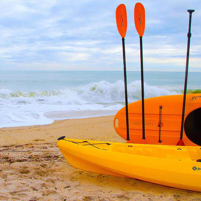 two kayaks on vero beach by the ocean