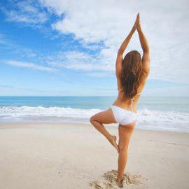 woman practicing yoga on vero beach