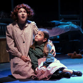 a woman and daughter in a play in vero beach