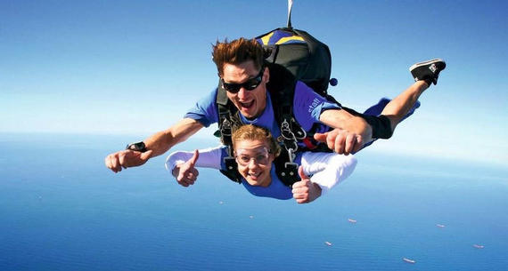 a man and woman skydiving