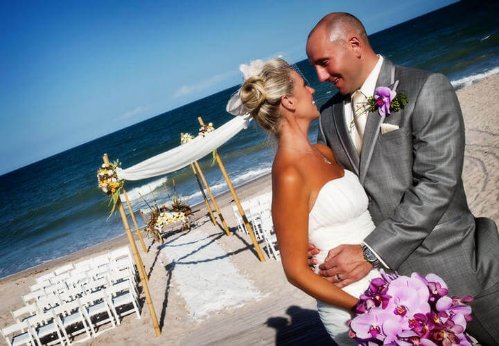 bride and groom embracing on the beach at costa d'este
