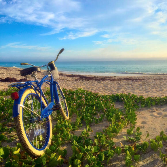 bike planted on the beach outside costa d'este